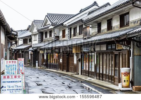 Kurashiki, Japan - April 28, 2014: View of Bikan historical area. It is the old merchant quarter and contains many examples of 17th century wooden warehouses painted white with traditional black tiles