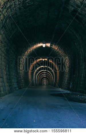 Old tunnel passageway with asphalt road for bikers and pedestrians
