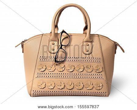 Elegant beige handbag and glasses isolated on white background