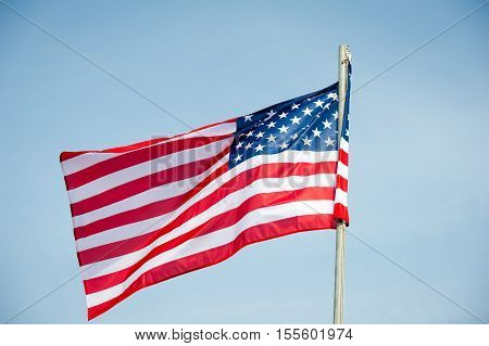 American flag - flag of America - USA flag. Election Day in the United States is the day set by law for the general elections of public officials.