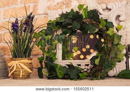 vintage wooden rectangular white frame with green plant. Floral scene