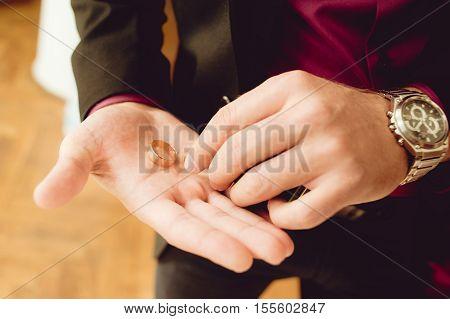 Wedding rings. Groom hands before wedding ceremony