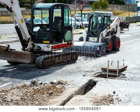 Mini excavators used for implementation of the new network infrastructure of optical fibers