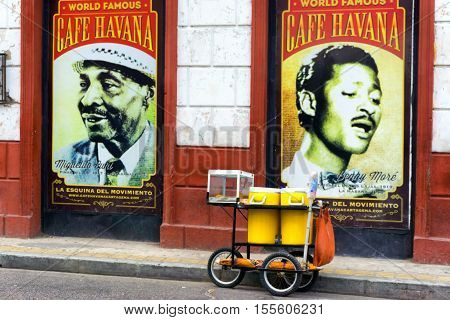 CARTAGENA COLOMBIA - MAY 24: Food cart in front of posters for Cafe Havana a bar known for live salsa music in Cartagena Colombia on May 24 2016