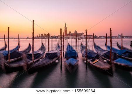 Scenic View Of Gondolas And San Giorgio Maggiore Basilica In Venice