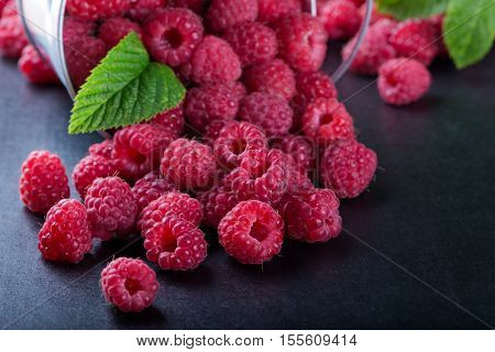 A Bucket With Scattered Berries