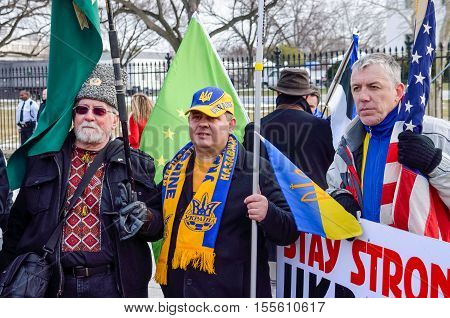 Washington DC, USA - March 6, 2014: Crowd of people at Ukrainian protest by White House with flags
