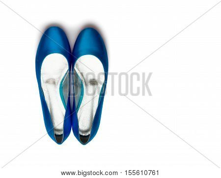 Blue female shoes on a white background