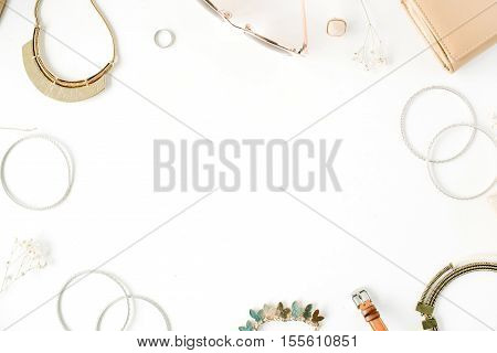 woman trendy fashion accessories frame arrangement on white flat lay top view