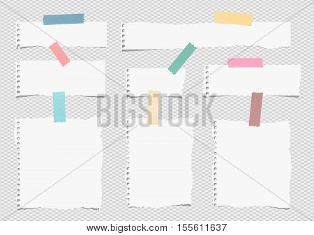 Pieces of white torn note, notebook paper sheets with colorful adhesive, sticky tape stuck on grey background.