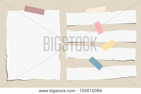 Pieces of white torn note, notebook paper sheets with colorful adhesive, sticky tape stuck on brown background.