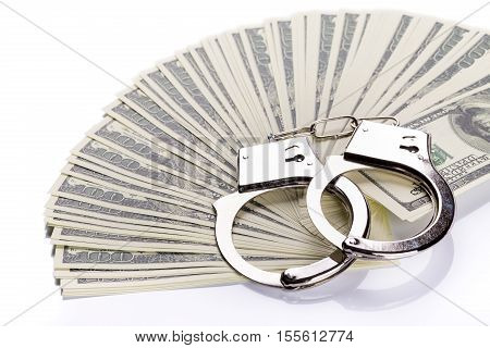 Pair Of Handcuffs Closeup On Dollar Banknotes Stack