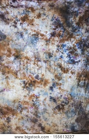 Abstrakter Hintergrund mit marmoriertem Muster in Braun und Blau