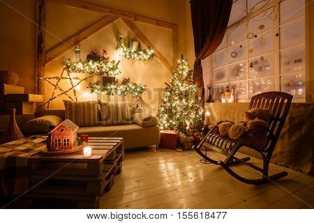 Calm image of interior modern home living room decorated christmas tree and gifts, sofa, table covered with blanket
