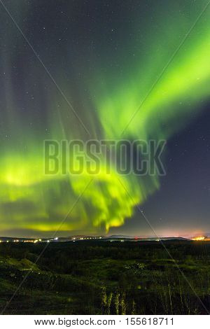 Bright Northern lights in the night sky