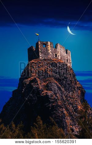 Fairy castle on high mountains top at night