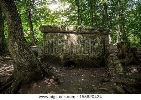 Ancient megalithic  dolmen in the mountain Adygea, Russia