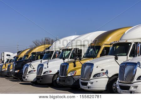Indianapolis - Circa November 2016: Colorful Semi Tractor Trailer Trucks Lined up for Sale II