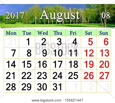 calendar for July 2017 on the background of summer landscape with thunder clouds and forest