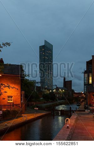 Manchester England - September 9 2016: Evening view of Castlefield district waterway canal area with Beetham Tower Manchester's tallest building in sight