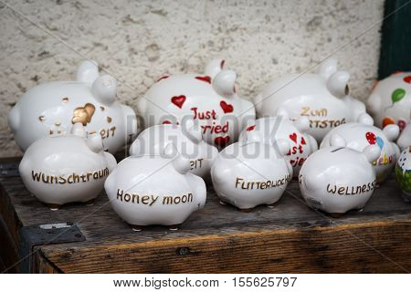 Large group of white piggy banks on desk