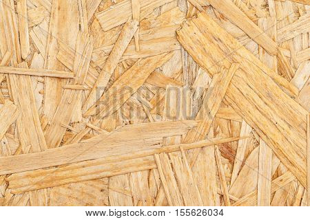Chipboard. Close up pressed wooden panel background OSB wood