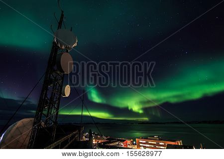 Northern lights over the arctic station, Nuuk city Greenland