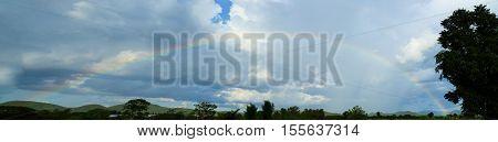 Clouds And Rainbow Panorama