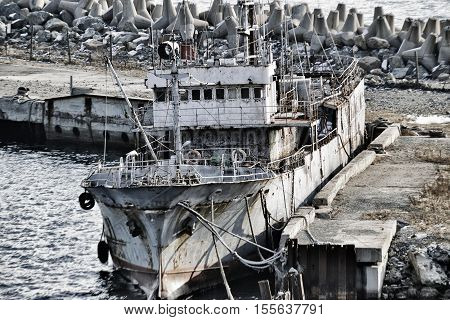 old fishing boat in the port berth