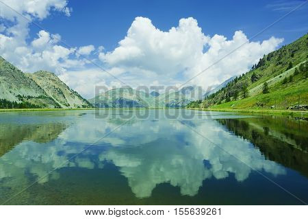 Beautiful mountain lake with clear water in French Alps