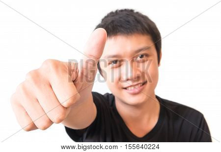 Closeup asian young man showing thumbs up with white background excellent symbol
