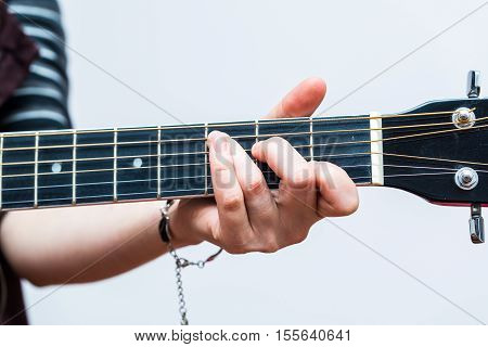 Woman Hands And Black Acoustic Guita