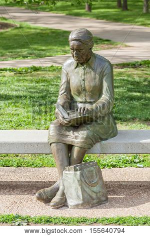 Springfield Missouri USA- May 18 2014. Reading woman statue in Nathanael greene park Springfield Missouri.