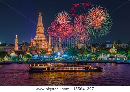 Wat arun and cruise ship in night time under new year celebration Bangkok city Thailand