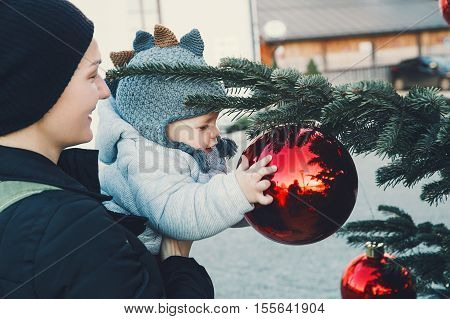Happy Family Spend Time At A Christmas Street Market And Fair