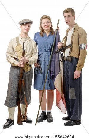 three young French Resistance vintage clothes and weapons reenactment two men and one woman