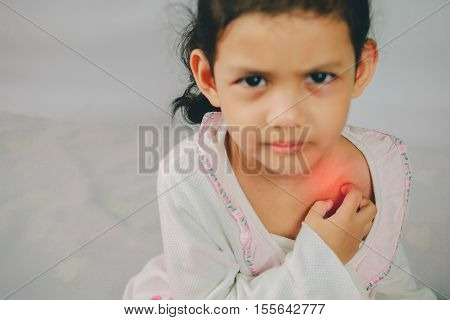 asia young girl scratch the itch with hand neck itching Healthcare And Medicine Concept.