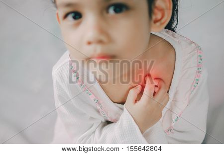 asia young girl scratch the itch with hand neck itching Healthcare And Medicine Concept