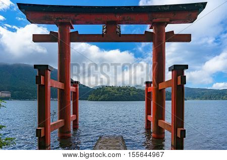 Bright Red Torii Gate In The Water