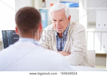Senior patient listening to the doctor in office