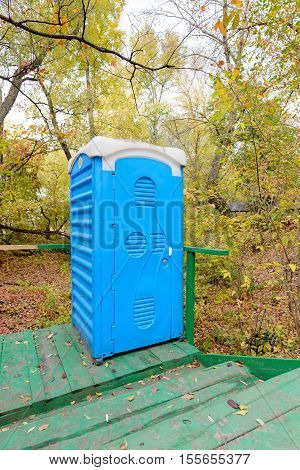 Blue Chemical Toilet In The Woods