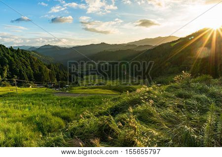 Sunset In The Mountains With Rice Paddy Fields And Forest