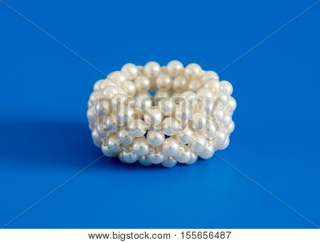 Scrunchy with pearl on a blue background