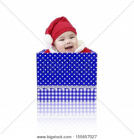 Asian baby cute and smile wearing SantaClaus suit playing in the open blue gift box for surprise on Christmas and Happy New Year day isolated on white