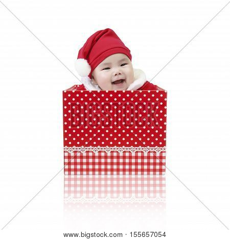 Asian baby cute and smile wearing SantaClaus suit playing in the open red gift box for surprise on Christmas and Happy New Year day isolated on white