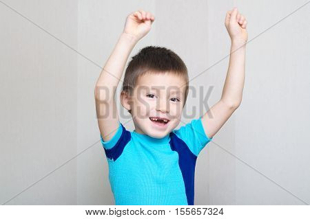 Happy Boy Shouting With Hands Up