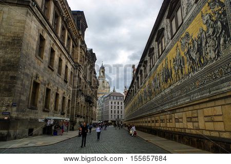 DRESDEN GERMANY - JULY 13 2015: the city center with historic buildings and the Fuerstenzug Procession of Princes a giant mural