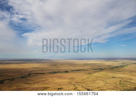The vast, flat expanse of the Great Plains, seen from atop Bear Butte in South Dakota.