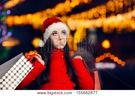 Tired Christmas Woman With Shopping Bags Looking for Presents in Xmas Fair