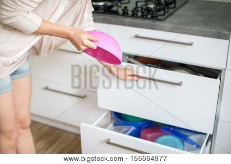 Young woman in her lovely, modern kitchen